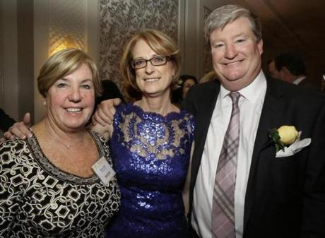 Deb Girard (center) of Acton with honored guest Tom Reilly and wife, Dianne, of Hingham.